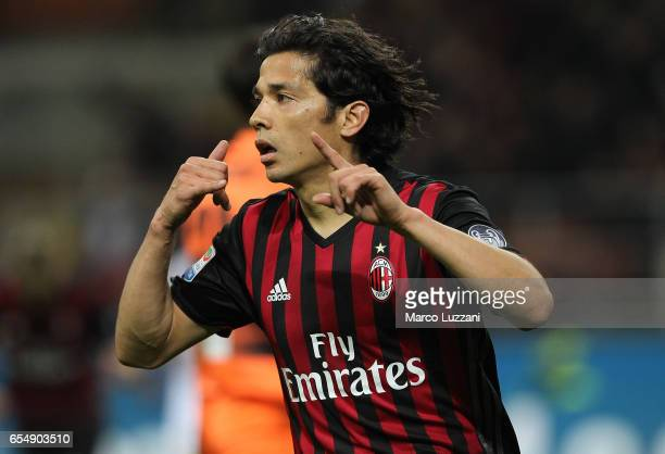 Mati Fernandez of AC Milan celebrates after scoring the opening goal during the Serie A match between AC Milan and Genoa CFC at Stadio Giuseppe...