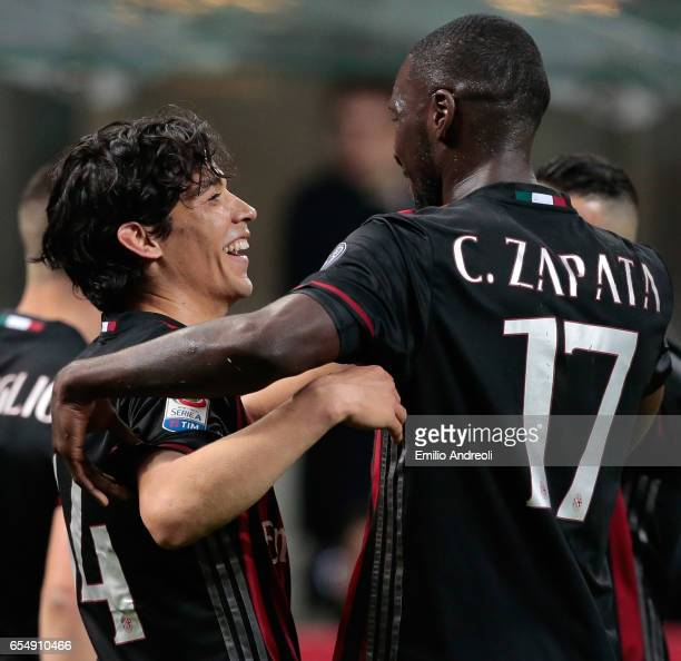 Mati Fernandez of AC Milan celebrates with his teammate Cristian Zapata after scoring the opening goal during the Serie A match between AC Milan and...