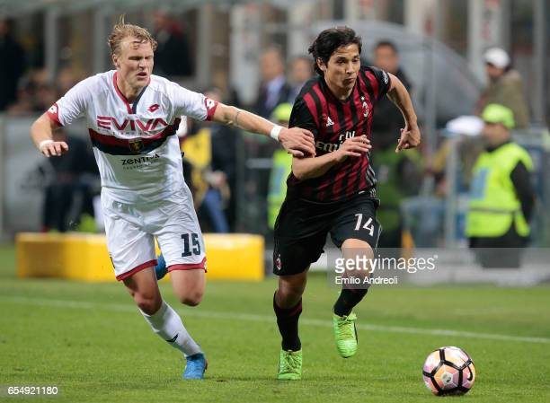 Mati Fernandez of AC Milan competes for the ball with Oscar Hiljemark of Genoa CFC during the Serie A match between AC Milan and Genoa CFC at Stadio...