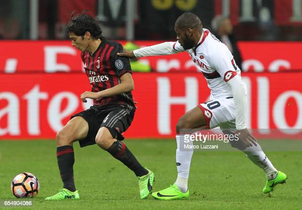 Mati Fernandez of AC Milan is challenged by Olivier Nitcham of Genoa CFC during the Serie A match between AC Milan and Genoa CFC at Stadio Giuseppe...