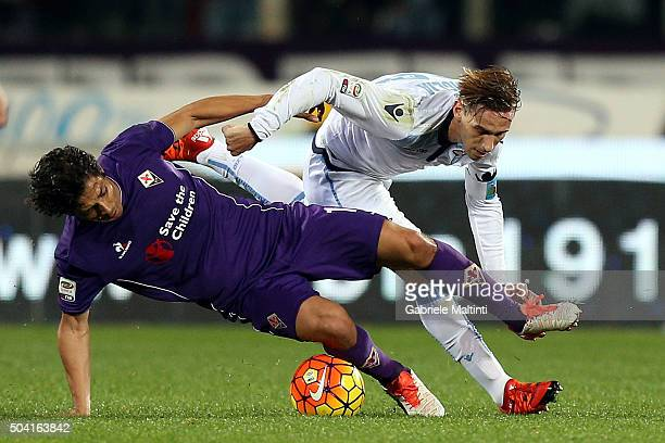 Mati Fernandez of ACF Fiorentina battles for the ball with Lucas Biglia of SS Lazio during the Serie A match between ACF Fiorentina and SS Lazio at...