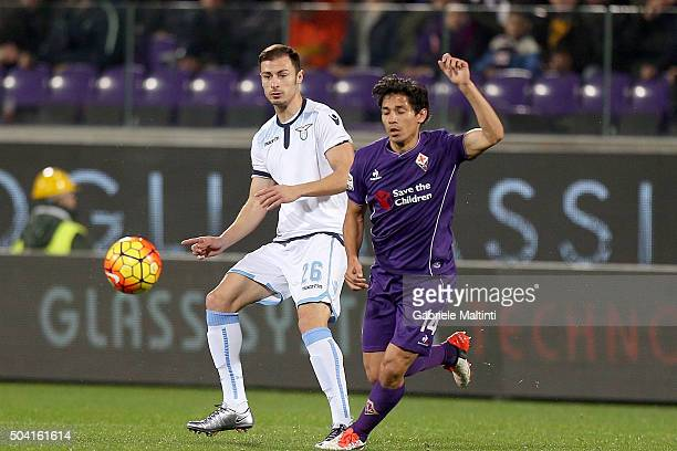 Mati Fernandez of ACF Fiorentina battles for the ball with Stefan Radu of SS Lazio during the Serie A match between ACF Fiorentina and SS Lazio at...