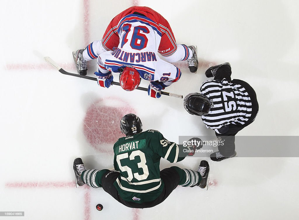 Matia Marcantuoni #91 of the Kitchener Rangers takes a faceoff against Bo Horvat #53 of the London Knights in an OHL game on January 5, 2013 at the Budweiser Gardens in London, Canada. The Knights defeated the Rangers 3-2.