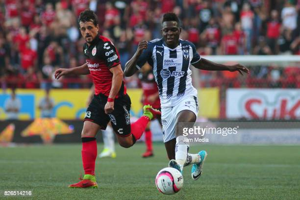 Matias Aguirregaray of Tijuana and Aviles Hurtado of Monterrey fight for the ball during the third round match between Tijuana and Monterrey as part...