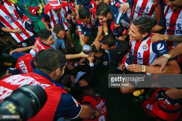 Matias Almeyda coach of Chivas celebrates with teammates with the champions trophy during the Final second leg match between Chivas and Tigres UANL...