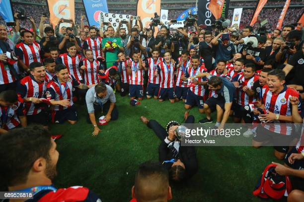 Matias Almeyda coach of Chivas celebrates with the champions trophy after the Final second leg match between Chivas and Tigres UANL as part of the...