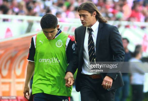 Matias Almeyda coach of Chivas gives instructions to his player Javier Lopez during the semi finals second leg match between Chivas and Toluca as...
