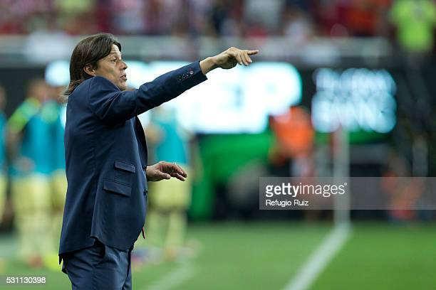 Matias Almeyda coach of Chivas gives instructions to his players during the quarter finals first leg match between Chivas and America as part of the...