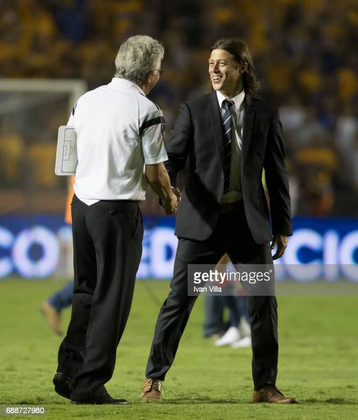 Matias Almeyda coach of Chivas greets Ricardo Ferretti coach of Tigres prior to the Final first leg match between Tigres UANL and Chivas as part of...