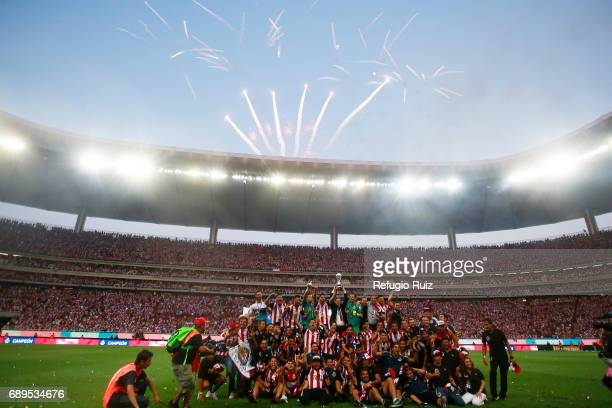 Matias Almeyda coach of Chivas lifts the champions trophy after winning the Final second leg match between Chivas and Tigres UANL as part of the...