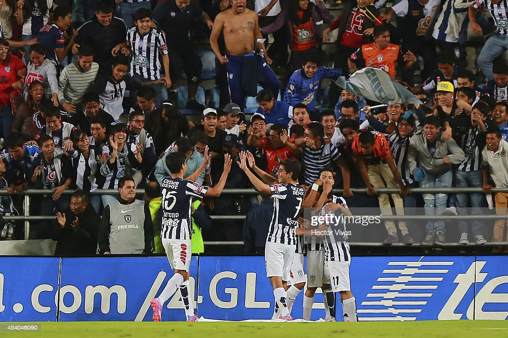 Matias Alustiza of Pachuca celebrate with teammates the first scored goal of his team during a match between Pachuca and Atlas as part of 6th round Apertura 2014 Liga MX at Hidalgo Stadium on August 23, 2014 in Pachuca, Mexico.