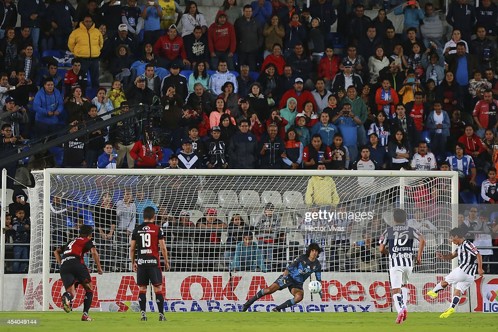 Matias Alustiza of Pachuca scores the third goal of his team during a match between Pachuca and Atlas as part of 6th round Apertura 2014 Liga MX at Hidalgo Stadium on August 23, 2014 in Pachuca, Mexico.