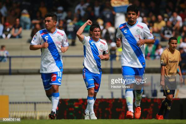 Matias Alustiza of Puebla celebrates after scoring the first goal of his team during the 3rd round match between Pumas UNAM and Puebla as part of the...