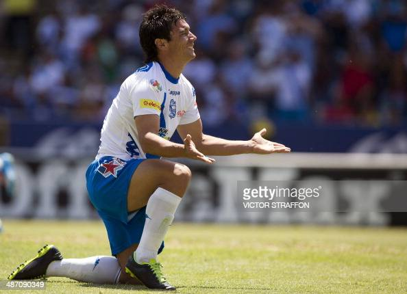 Matias Alustiza of Puebla reacts after missing his shot against Morelia during their Mexican Soccer Clausura 2014 tournament in Puebla State Mexico...