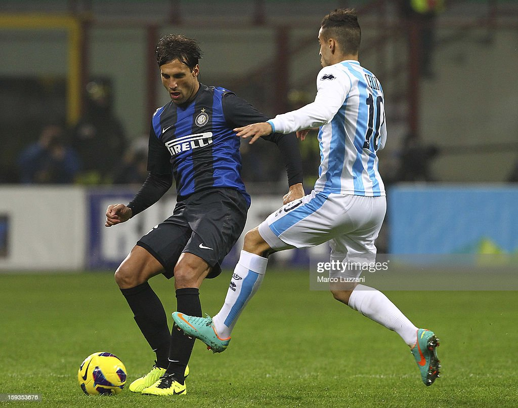 Matias Augustin Silvestre of FC Internazionale Milano competes for the ball with Mervan Celik of Pescara Calcio during the Serie A match between FC Internazionale Milano and Pescara at San Siro Stadium on January 12, 2013 in Milan, Italy.