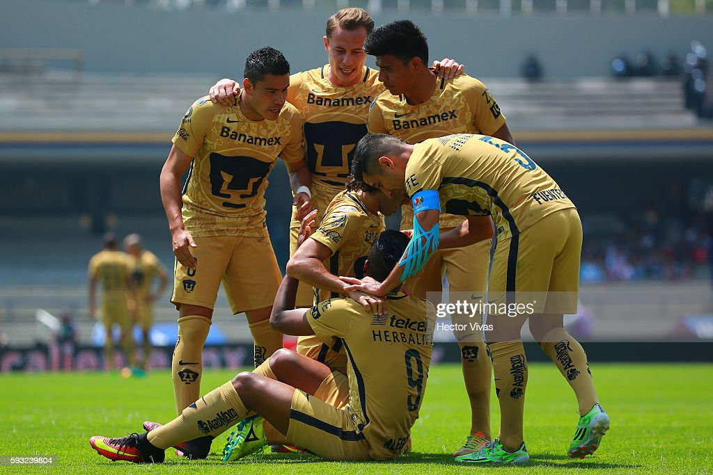 Matias Britos of Pumas celebrate with teammates after scoring the second goal of his team during the 6th round match between Pumas UNAM and Monterrey...