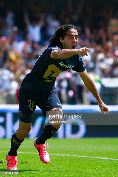 Matias Britos of Pumas celebrates after scoring during the 12th round match between Pumas UNAM and Chiapas as part of the Torneo Apertura 2016 Liga...