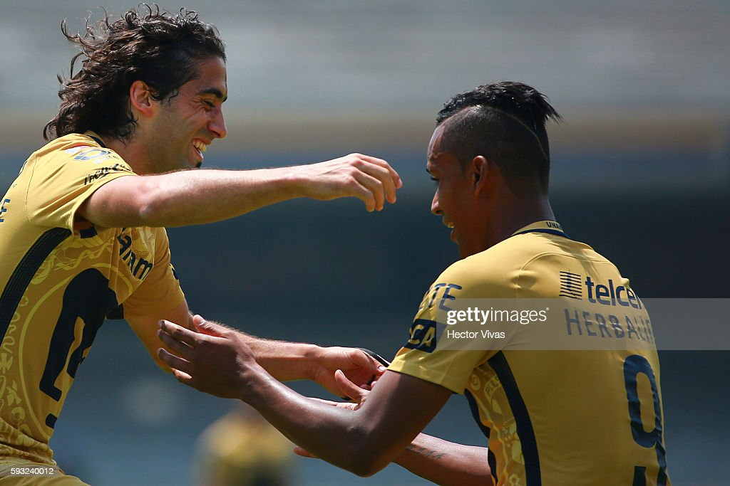 Matias Britos of Pumas celebrates with teammate Fidel Martinez after scoring the second goal of his team during the 6th round match between Pumas...