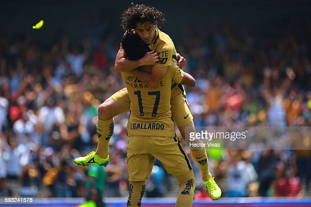 Matias Britos of Pumas celebrates with teammate Jesus Gallardo after scoring the third goal of his team during the 6th round match between Pumas UNAM...