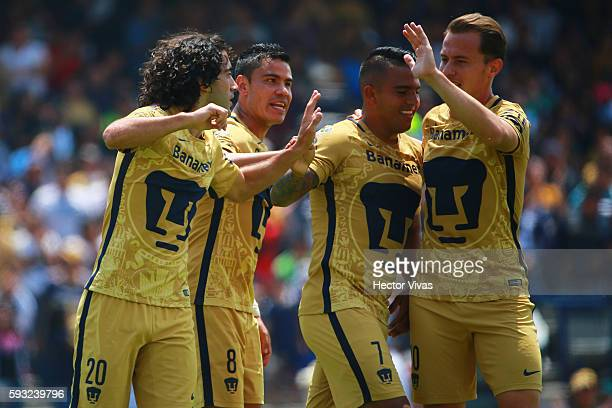 Matias Britos of Pumas celebrates with teammates after scoring the first goal of his team during the 6th round match between Pumas UNAM and Monterrey...