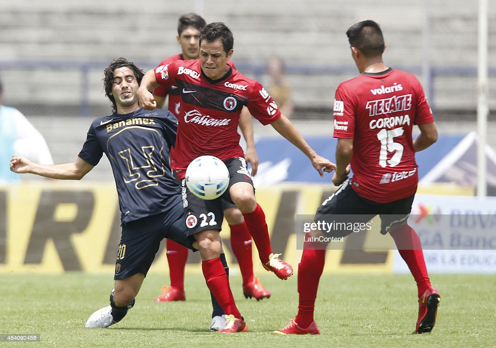 Matias Britos of Pumas UNAM figths for the ball with Juan Carlos Nuñez of Xolos Tijuana during a match between Pumas UNAM and Xolos Tijuana as part of 6th round Apertura 2014 Liga MX at Olimpic Stadium on August 24, 2014 in Mexico City, Mexico.