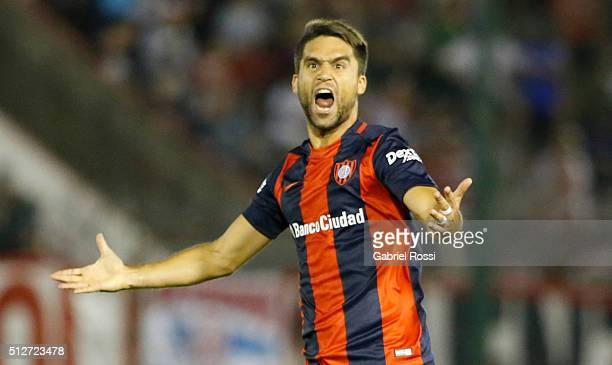 Matias Caruzzo of San Lorenzo celebrates the first goal of his team scored by Fernando Belluschi of San Lorenzo during a fifth round match between...