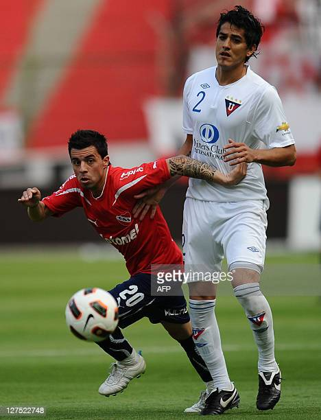 Matias Defederico of Argentina's Independiente vies for the ball with Norberto Araujo of Ecuador's Liga de Quito during their Copa Sudamericana...