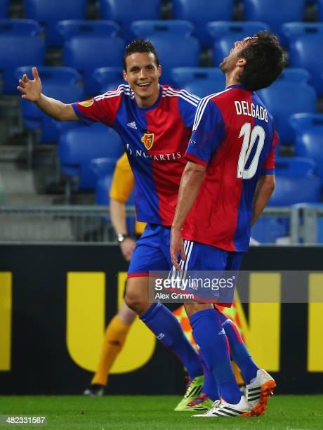 Matias Delgado of Basel celebrates his team's first goal with team mate Philipp Degen during the UEFA Europa League Quarter Final first leg match...