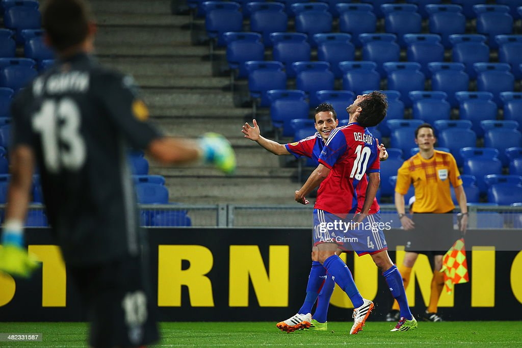Matias Delgado #10 of Basel celebrates his team's first goal with team mate <a gi-track='captionPersonalityLinkClicked' href=/galleries/search?phrase=Philipp+Degen&family=editorial&specificpeople=534432 ng-click='$event.stopPropagation()'>Philipp Degen</a> during the UEFA Europa League Quarter Final first leg match between FC Basel 1893 and FC Valencia at St. Jakob-Park on April 3, 2014 in Basel, Switzerland.
