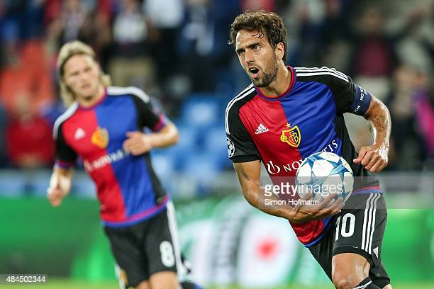 Matias Delgado of Basel celebrates scoring his team's first goal during the UEFA Champions League qualifying round play off first leg match between...