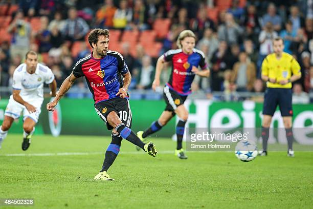 Matias Delgado of Basel scores his team's first goal with a penalty kick during the UEFA Champions League qualifying round play off first leg match...