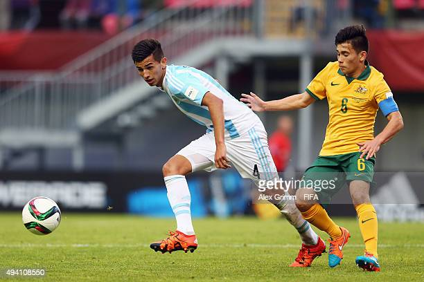 Matias Escudero of Argentina is challenged by Joe Caletti of Australia during the FIFA U17 World Cup Chile 2015 Group C match between Argentina and...