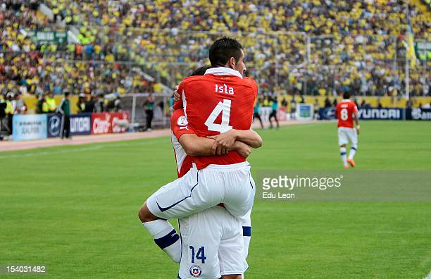 Matias Ferandez and Mauricio Isla celebrate a goal during a match between Ecuador and Chile as part of the South American Qualifiers for the FIFA...