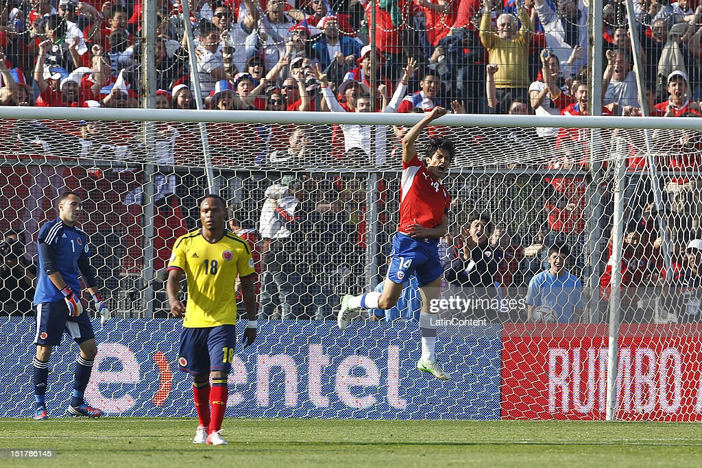 Matias Fernandez of Chile celebrates a goal during a match between Chile and Colombia as part of the South American Qualifiers for the FIFA Brazil...