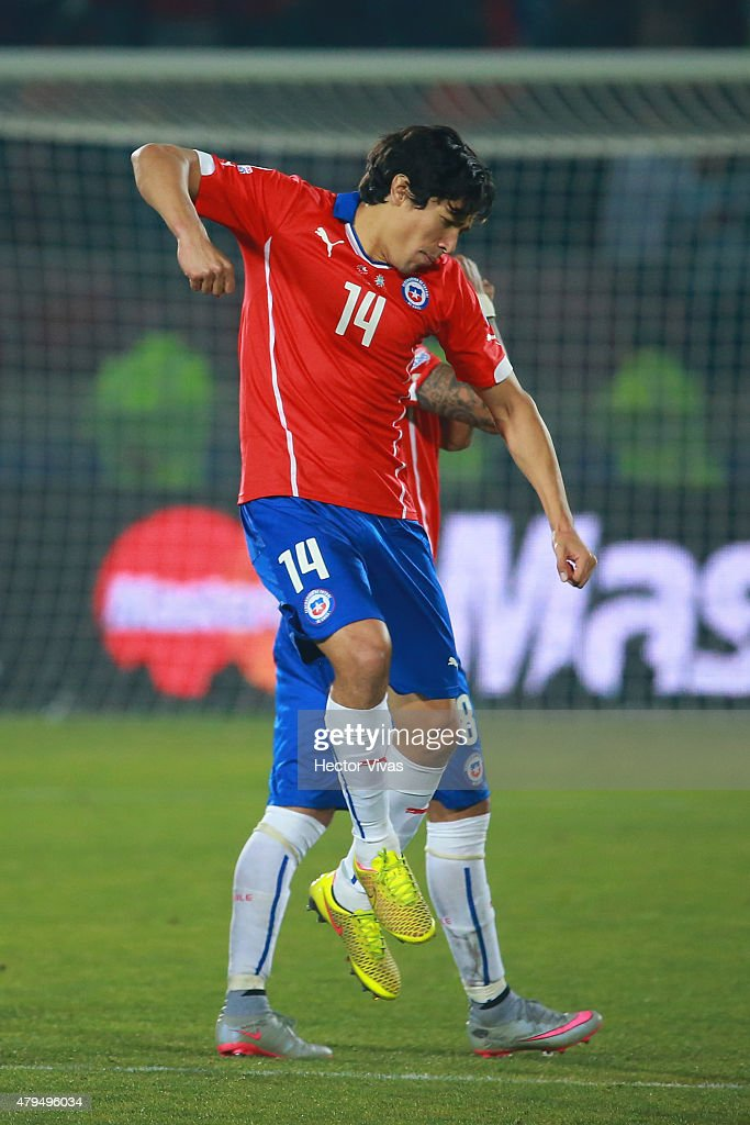 Matias Fernandez of Chile celebrates after scoring the first penalty kick in the penalty shootout during the 2015 Copa America Chile Final match...