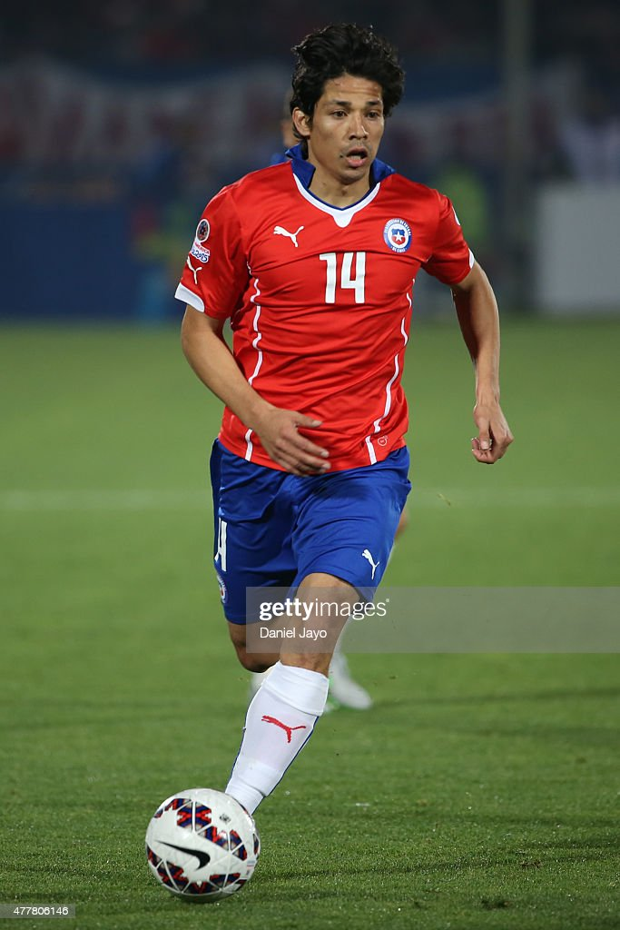Matias Fernandez of Chile drives the ball during the 2015 Copa America Chile Group A match between Chile and Bolivia at Nacional Stadium on June 19...