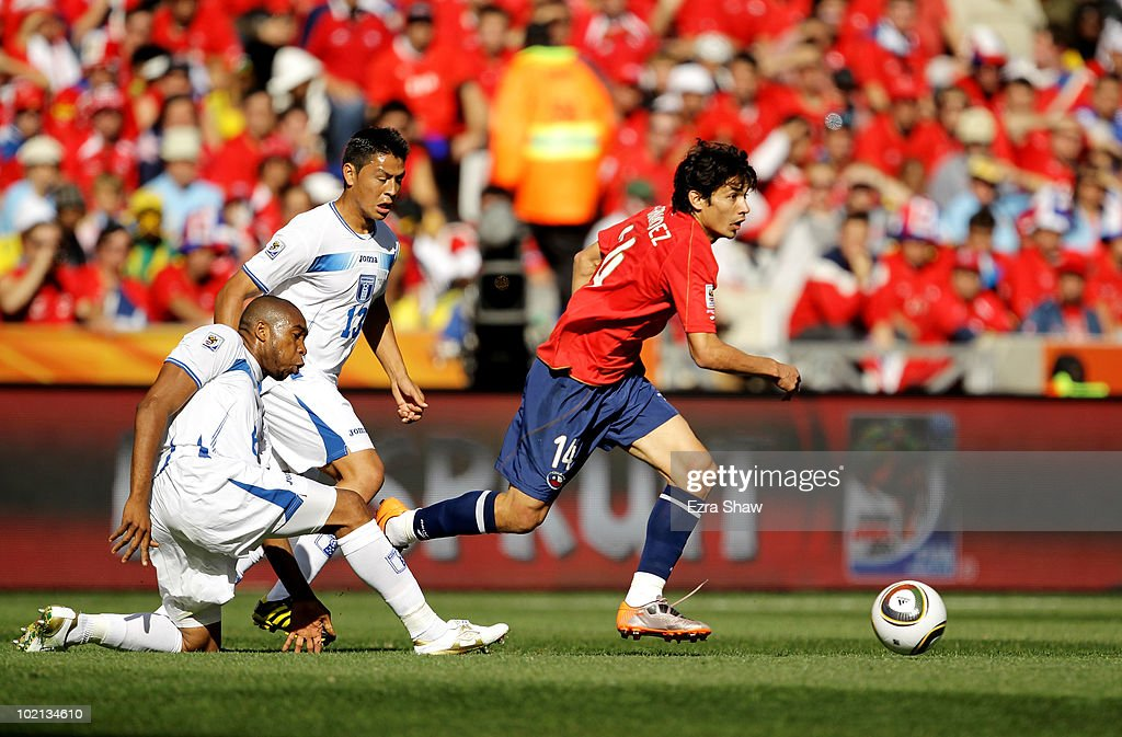 Matias Fernandez of Chile rides the tackle of Wilson Palacios of Honduras during the 2010 FIFA World Cup South Africa Group H match between Honduras...