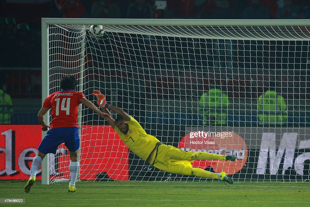 Matias Fernandez of Chile scores the first penalty kick in the penalty shootout during the 2015 Copa America Chile Final match between Chile and...