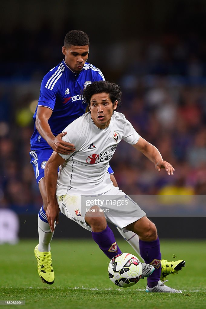 Matias Fernandez of Fiorentina holds off a challenge from Ruben LoftusCheek of Chelsea during a Pre Season Friendly between Chelsea and Fiorentina at...