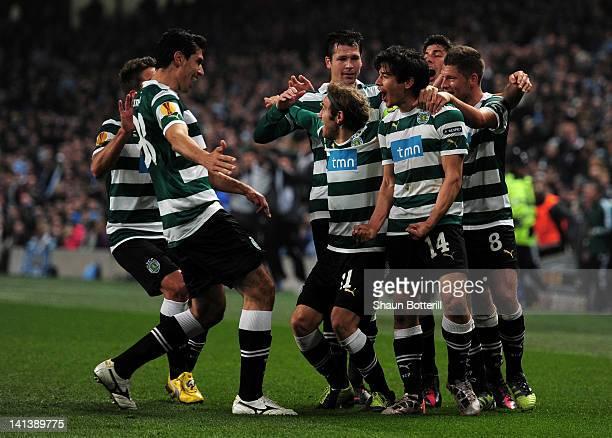 Matias Fernandez of Sporting Lisbon celebrates scoring their first goal with team mates during the UEFA Europa League round of 16 second leg match...