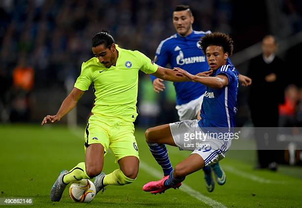 Matias Iglesias of Asteras challenges Leroy Sane of Schalke during the UEFA Europa League Group K match between FC Schalke 04 and Asteras Tripolis FC...