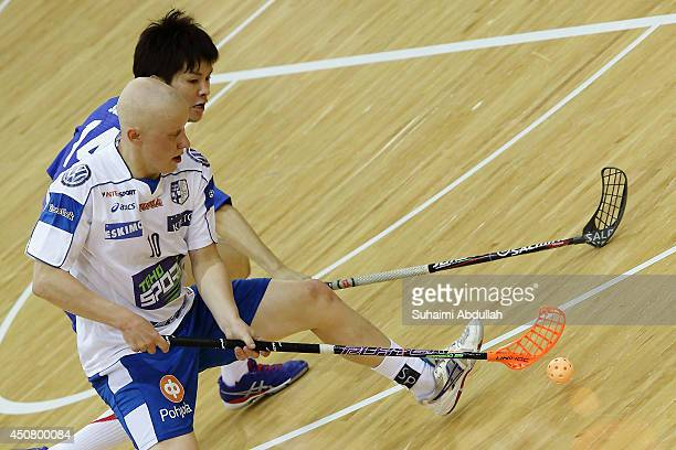 Matias Kaartinen of Finland and Yuta Suzuki of Japan challenge for the ball during the World University Championship Floorball match between Japan...