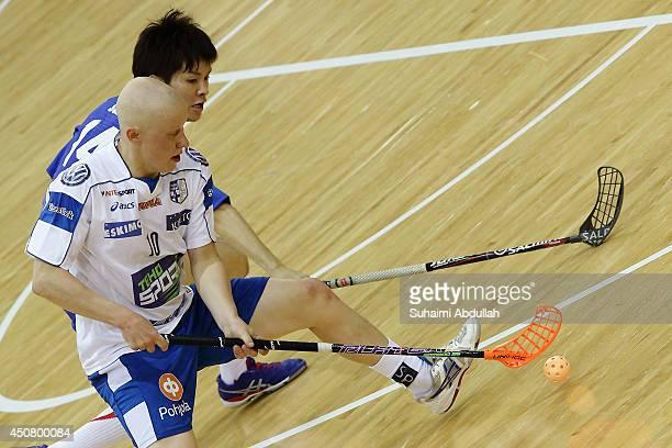 Matias Kaartinen of Finland and Yuta Suzuki of Japan challenge for the ball during the World University Championship Floorball match between Japan...