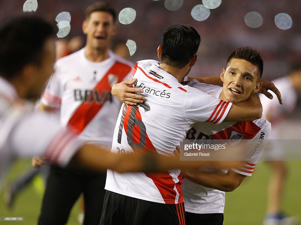 Matias Kranevitter and Ariel Rojas of River Plate celebrate after winning the second leg final match between River Plate and Atletico Nacional as part of Copa Total Sudamericana 2014 at Antonio Vespucio Liberti Stadium on December 10, 2014 in Buenos Aires, Argetina.