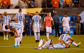 Matias Kranevitter Erik Lamela and Sergio Aguero look dejected after losing in penalty kicks the championship match between Argentina and Chile at...