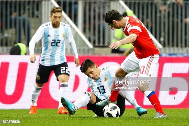 Matias Kranevitter of Argentina in action against Alan Dgazoev of Russia during the international friendly match between Russia and Argentina at BSA...