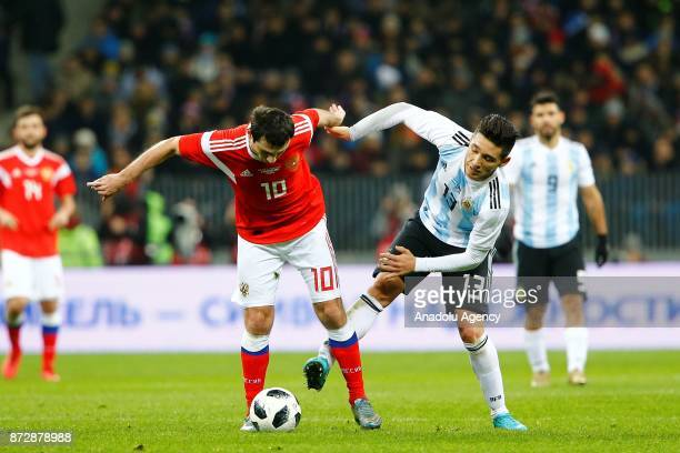 Matias Kranevitter of Argentina in action against Alan Dzagoev of Russia during the international friendly match between Russia and Argentina at BSA...