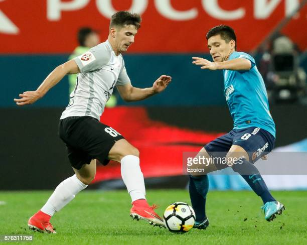 Matias Kranevitter of FC Zenit Saint Petersburg and Marco Poletanovic of FC Tosno vie for the ball during the Russian Football League match between...