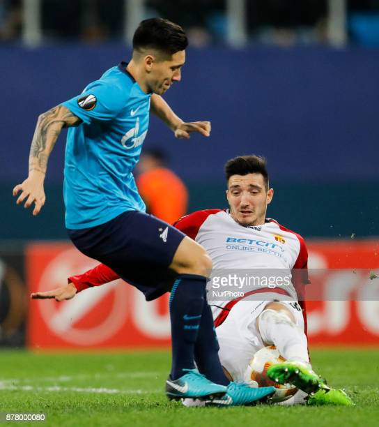 Matias Kranevitter of FC Zenit Saint Petersburg and Vanja Markovic of FK Vardar vie for the ball during the UEFA Europa League Group L match between...