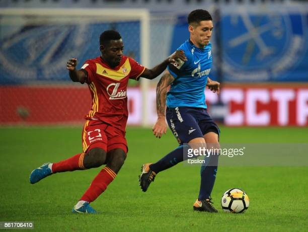 Matias Kranevitter of FC Zenit St Petersburg vies for the ball with Evans Kangwa of FC Arsenal Tula during the during the Russian Premier League...